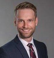 Attorney John W. Menn of the Wisconsin Law Firm Steinhilber Swanson LLP
